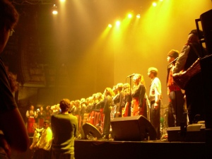 the London Bulgarian Choir onstage with British Sea Power at the Roundhouse